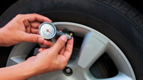 checking the tire pressure on a car