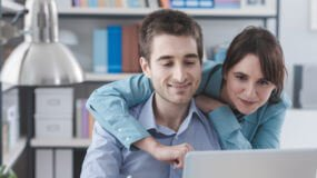 Young Couple shopping for insurance online